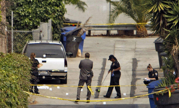 Police investigate a double shooting Tuesday morning in the 1500 block of Michigan Avenue in Santa Monica.