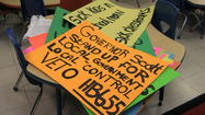 Signs ready for distribution at event aimed at convincing Gov. Rick Scott to veto legislation.