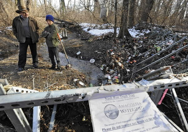 Trash trap run by Anacostia Watershed Society on Nash Run has collected fewer plastic bags as a share of all debris trapped since the District of Columbia started charging a nickel for each disposable paper or plastic merchandize bag.