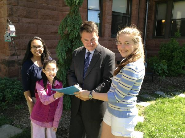 All 16 West Hartford school principals have committed to Connecticut's Green LEAF Schools program, which encourages schools to increase environmental learning and improve the health and wellness of students and teachers. Pictured from left are seventh grade science teacher Priya White, seventh grader Rebekah Kim, Principal Andrew Morrow and seventh grader Elizabeth Rousseau, all of Bristow Middle School.