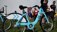 "The launch of Chicago's Divvy bicycle-sharing service, set for Friday, will be postponed for two weeks to allow ""more extensive testing"" of equipment, the city's transportation commissioner told the Tribune on Tuesday."