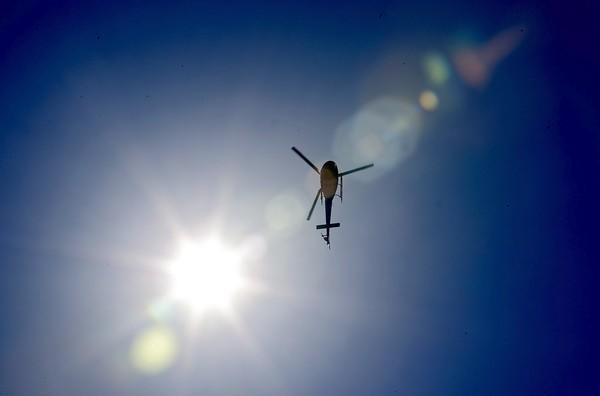 An LAPD helicopter hovers over Crenshaw Boulevard.