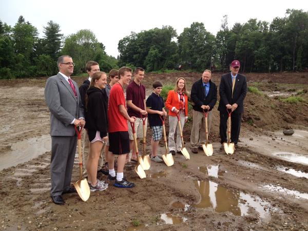 Town and school officials along with students at the groundbreaking ceremony held on June 11 for the track and playing field project at Canton High School.
