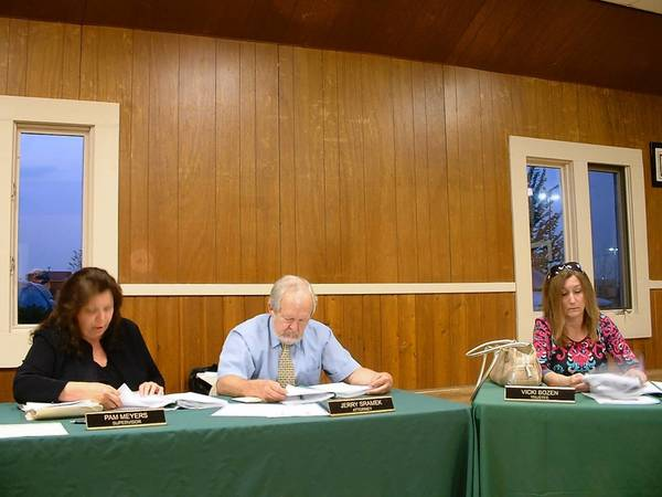 Homer Township Supervisor Pam Meyers, left, and attorney Gerald Sramek and Trustee Vicki Bozen discuss township business at the Monday meeting.