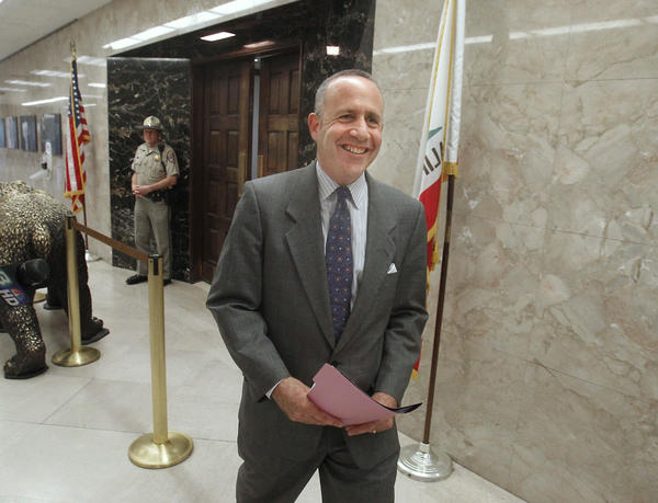 Senate President Pro Tem Darrell Steinberg (D-Sacramento) smiles as he leaves Gov. Jerry Brown's office after a budget meeting with Brown and Assembly Speaker John Perez (D-Los Angeles) in Sacramento.