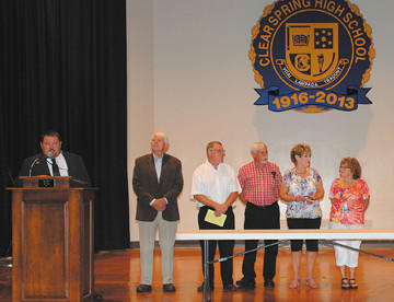 Clear Spring High School Principal James Aleshire, left, announces a gift of $3,900 to the school from the Class of 1963, represented by, from left, James Reger, Brian Moore, Clyde Faith, Lynn Holtzman Hunsberger and Merry Weber Gehr. Carolyn Keefer Rhodes was present but is not in the picture.