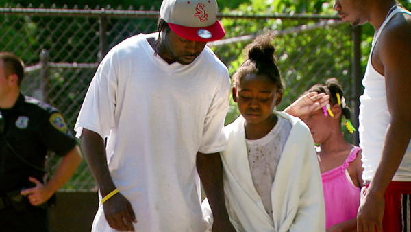 WSBT photo/Demarco Brown Leron Kindred, left, walks with his 10-year-old daughter, Leronda Cleveland, after a bystander pulled her from the St. Joseph River on Tuesday afternoon. Kindred said he feels blessed a complete stranger would act to save his daughter's life.