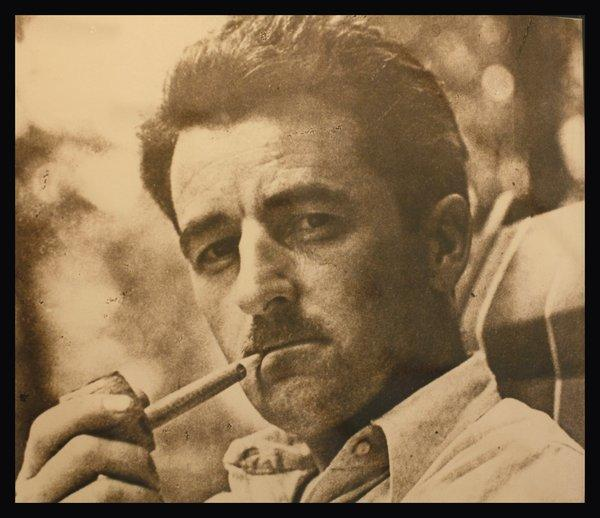 A photograph of William Faulkner on display at Rowan Oak, his home in Oxford, Miss.