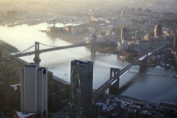 This file photo of May 10, 2013 shows view of the Manhattan Bridge, left, and Brooklyn Bridge as seen from the 105th floor of One World Trade Center, in New York. Seven months after Superstorm Sandy swamped New York, Mayor Michael Bloomberg proposed a nearly $20 billion plan Tuesday, June 11, 2013, to protect the city from the effects of global warming and storms.