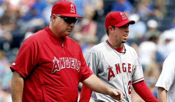 Sean Burnett's second visit to Dr. James Andrews didn't end with a surgical procedure, but the Angels left-hander has been ordered not to pick up a ball for a month.
