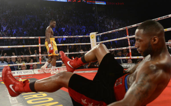 Jun 8, 2013; Montreal, Quebec, Canada; Adonis Stevenson (gold/yellow) knocks out Chad Dawson (black) during the first round of their light heavyweight WBC title bout at the Bell Centre. Mandatory Credit: Eric Bolte-USA TODAY Sports ORG XMIT: USATSI-133488