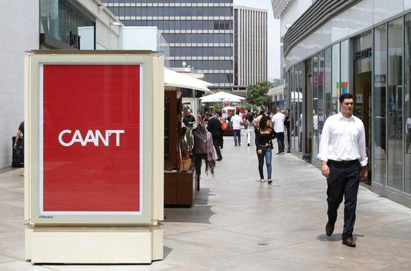 "The Westfield Century City mall has been plastered with advertisements -- several dozen -- that poke fun at talent agency CAA. The ads say ""CAAN'T"" and are written in the iconic CAA font and color."