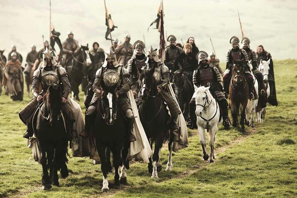 [Scene from the HBO series Game of Thrones. Sean Bean; Kit Harington; Peter Dinklage; Joesph Mawle.