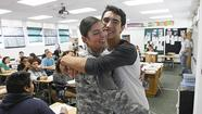 David Peterson, assistant principal at Costa Mesa High School, walked into Paul Grady's literature class and called Trevor Davis to the door Tuesday afternoon.
