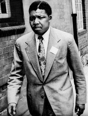 "In 1961, Nelson Mandela was a political activist who had already been arrested once for his work with the African National Congress. Born in 1918 to a chief of the small Thembu tribe, he was given the name Rolihlahla ""troublemaker"" in the Xhosa language. A Methodist teacher renamed him Nelson."