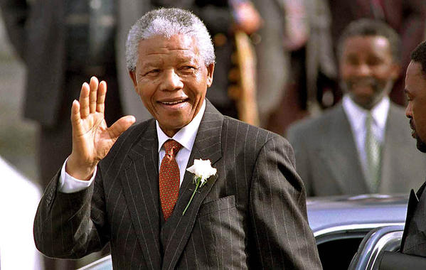 Mandela heads into parliament May 9, 1994, shortly before the new majority officially voted to appoint him president.