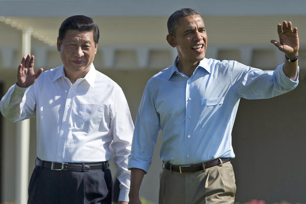 "President Barack Obama and Chinese President Xi Jinping, left, walk at the Annenberg Retreat of the Sunnylands estate in Rancho Mirage. While saying it is critical that the U.S. and China reach a ""firm understanding"" on cyber issues, Obama told reporters his meetings with Xi have been ""terrific."""