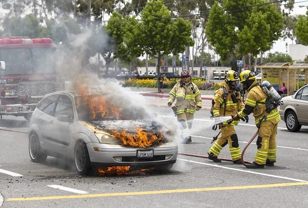 Costa Mesa Firefighters put out a car fire on Fairview Road across from Costa Mesa High School on Tuesday.