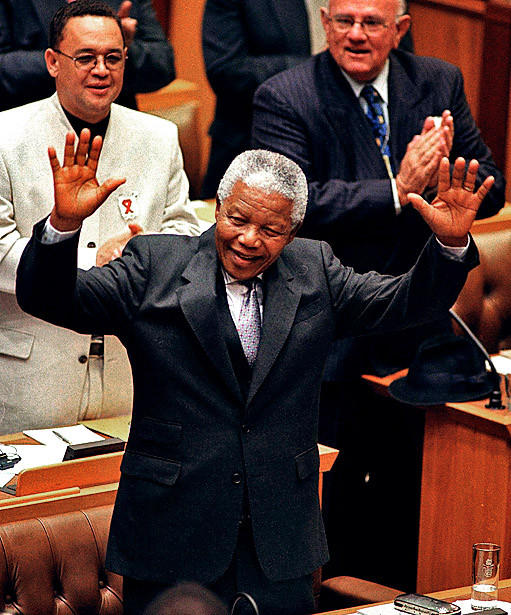 Mandela acknowledges a standing ovation after his final address as president to a joint session of parliament in Cape Town, South Africa in March, 1999.