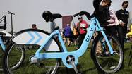 "The launch of Chicago's Divvy bicycle-sharing service, set for Friday, will be postponed two weeks to allow ""more extensive testing"" of equipment, the city's transportation commissioner told the Tribune on Tuesday."