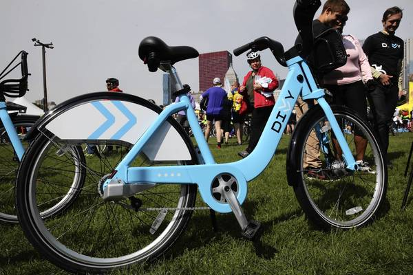The debut of the city's Divvy bicycle-sharing service is being pushed back to June 28.