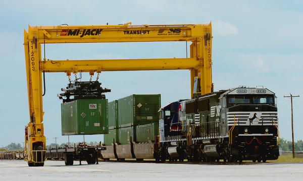 An ocean container is lifted off a train onto a chassis at Norfolk Southern's new Franklin County Regional Intermodal Facility in Greencastle, Pa., on Tuesday.