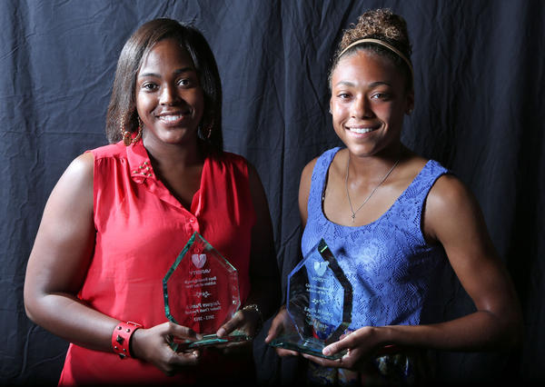 Yasmeen Patrick, left, accepted the boys Breakthrough Athlete of the Year for her son, Jacques Patrick of Timber Creek. East Ridge's Kaylin Whitney, right, won the girls award.