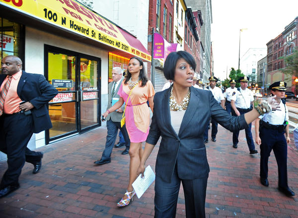 Mayor Stephanie Rawlings-Blake, center, and police commissioner Anthony W. Batts and their entourages walk along Howard Street toward the Inner Harbor to talk with business owners about crimes in the downtown and Inner Harbor areas. The tour started after a visit to Baltimore Police CitiWatch headquarter on Howard Street.