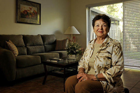 Commissioner Pat Flury, shown here in a town home she rents in Dania Beach, resigned Tuesday in the middle of a City Hall meeting.