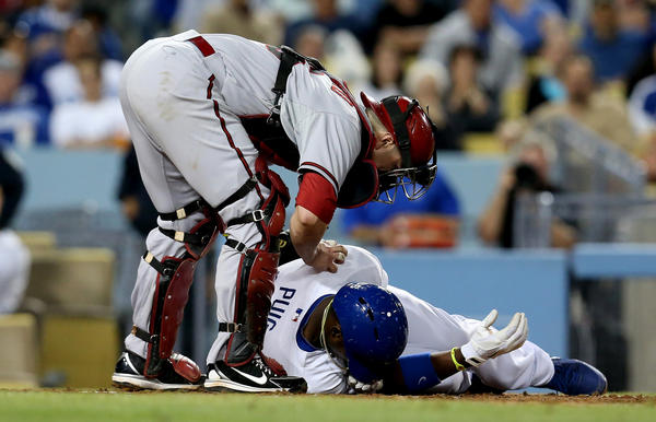 Dodgers' Yasiel Puig went down after being hit by a pitch in the sixth inning at Dodger Stadium.