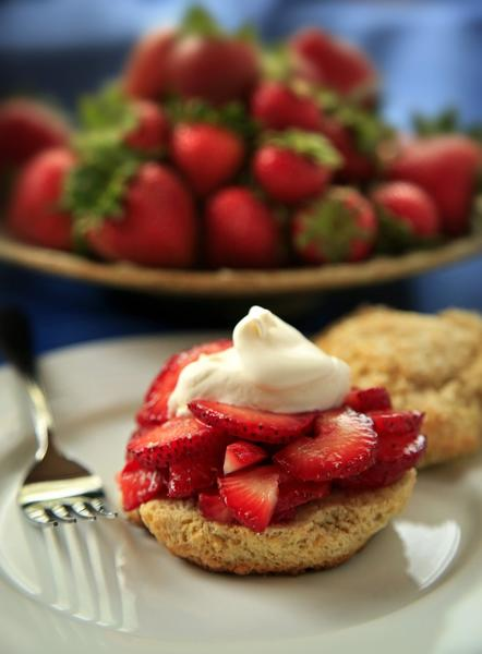Strawberry shortcake topped with a dollop of whipped cream is a delectable creation.