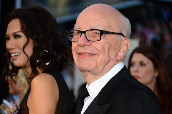 Media mogul Rupert Murdoch and wife Wendi Deng Murdoch arrive on the red carpet for the 85th Academy Awards. News Corp shareholders approved a plan to split the Rupert Murdoch-led conglomerate into two independent firms.