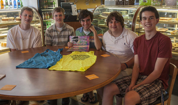Robert King, left, Jacob Skwarcan, Nick King, Chris Agostino and Kevin Barrett sit in the South Bend Chocolate Co. Chocolate Cafe in South Bend. The group is hosting a benefit concert of local bands for the food bank on Thursday.