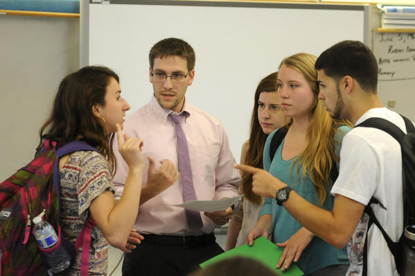 WINDSOR, CT; 6/5/2013: Windsor High School teacher of the year Chris Todd talks with seniors for left Gwendolyn Peyton, Amanda Purdue, Nicole Bach and Brian Casanovas about public service announcement project they are working on. Todd teaches history at the school.