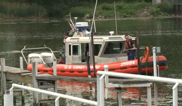 Coast Guard personnel search for a man who went swimming and disappeared in the Calumet River Tuesday. The man's body was later found in the river.