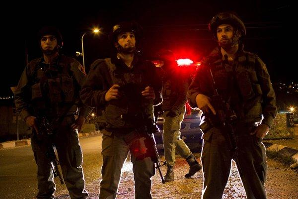 Israeli soldiers guard an entrance to the Jewish settlement of Itamar in 2011 after a Palestinian infiltrated the settlement and killed five people.
