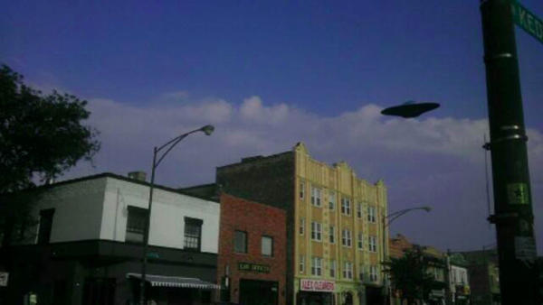 A photo and report claim there was a UFO over Logan Square Tuesday.