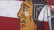Father, son duo create giant Blackhawks mural on Chicago building