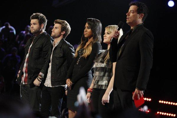 "From left, Zach and Colton Swon of the Swon Brothers, Sasha Allen, Amber Carrington and Carson Daly on ""The Voice."""