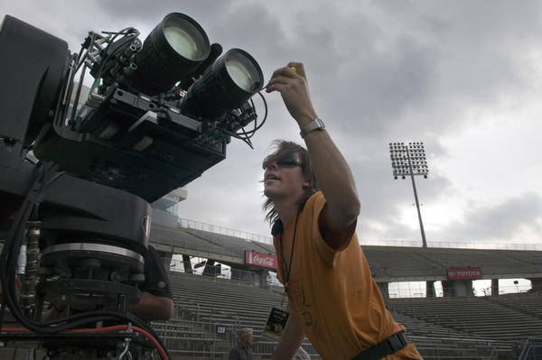 Justin Phelps, a 3D system tech, makes adjustments to a 3D camera during testing by ESPN at Rentschler Field in 2010.