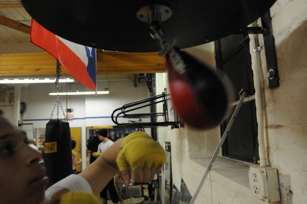 "Mykquan ""Mikey"" Williams of East Hartford hits the speed bag at the Manchester Ring of Champions boxing club. The organization is raising money to send the 15-year-old fighter to a qualifying tournament for the U.S. Junior Olympic team in Mobile, Ala."