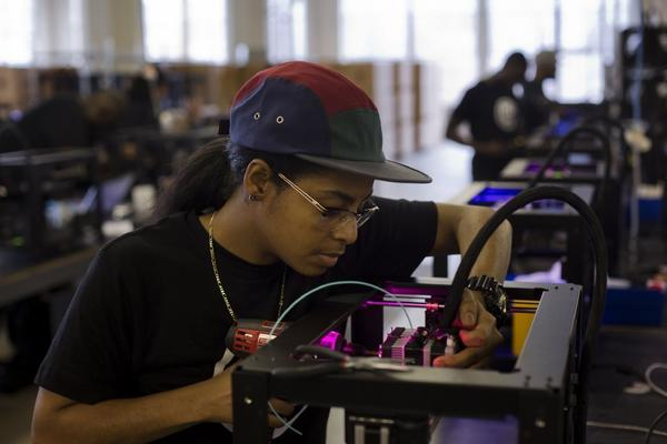 Economic activity is expected to remain fairly slow in the near future. Above, Imanei Cedeno assembles a Makerbot Industries 3-D printer at the company's new factory in Brooklyn, N.Y.