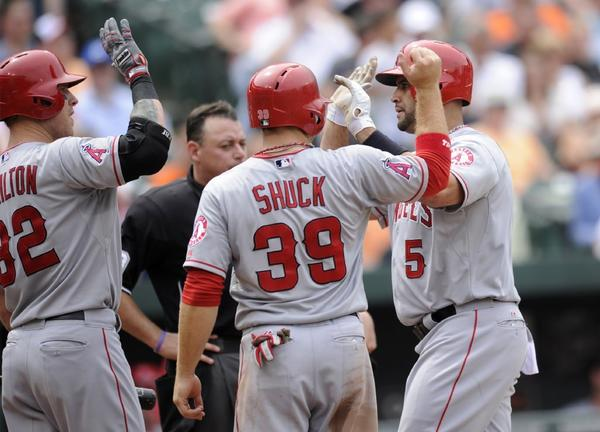 Albert Pujols, right, celebrates his two-run home run against Baltimore with teammates Josh Hamilton and J.B. Shuck during the seventh inning Wednesday.