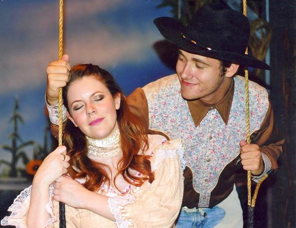 Luke Carlsen woos Andrea Dennison-Laufer in the musical comedy Oklahoma! at the Newport Theatre Arts Center.