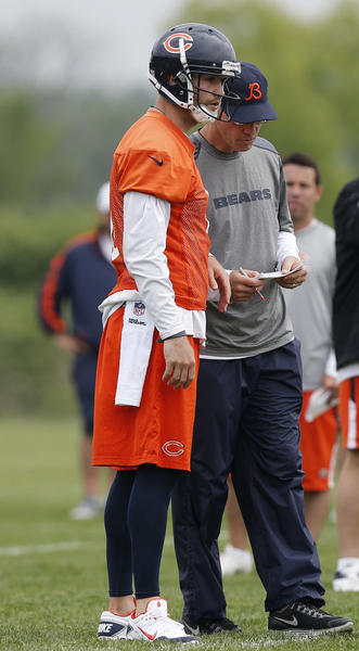 Bears quarterback Jay Cutler talks with head coach Marc Trestman at minicamp.