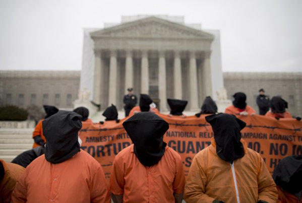 Demonstrators, dressed as detainees, protest against the U.S. military detention facility in Guantanamo Bay, Cuba, in front of the Supreme Court in Washington.