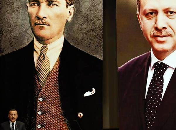 Turkey's Prime Minister Recep Tayyip Erdogan addresses the members of his ruling AK Party, as he stands in front of the portraits of Mustafa Kemal Ataturk, founder of modern Turkey, and himself during a meeting at his party headquarters in Ankara.