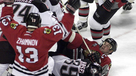 Blackhawks center Alexei Zhamnov celebrates a goal after right winger Tony Amonte falls on Sabers' goalie Dominik Hasek in an October 2000 game in Buffalo. The goal was called back after an interference ruling and Buffalo won 4-2.