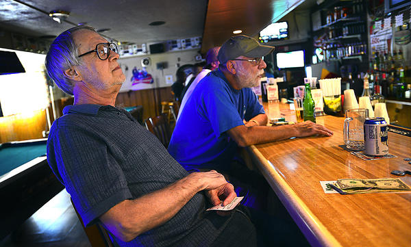 Jim Slayman and fellow West End Pub regular Tony Bowers sit Wednesday morning at the Hagerstown bar.