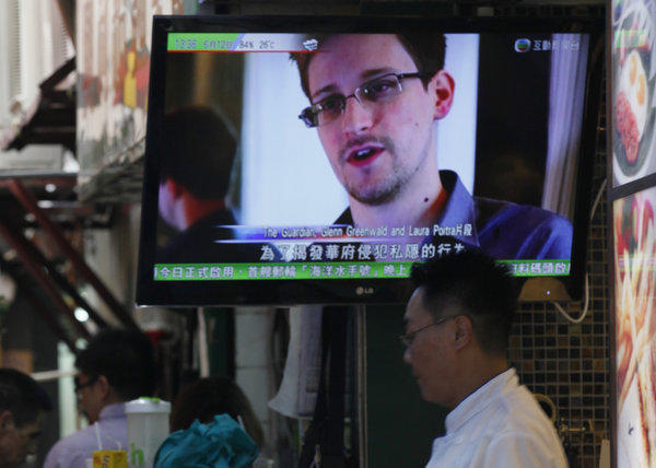 A TV screen shows news of Edward Snowden, who says he leaked top-secret U.S. documents about sweeping surveillance programs, at a restaurant in Hong Kong.